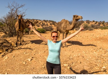 Morocco Agadir 20.04.2018 - tourist with camels in background