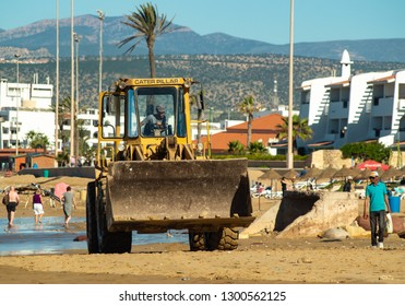 Morocco Agadir December 10th 2018 - Main Beach JCB Caterpillar Digger on Sand