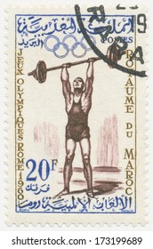 MOROCCO - CIRCA 1960: A stamp printed in Morocco shows Weight lifter, series 17th Olympic Games, Rome, circa 1960