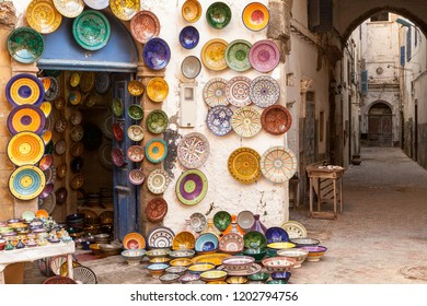 Morocco Essaouira colorful ceramics and pottery displayed outside a shop in a maze of pedestrian shopping alleys.