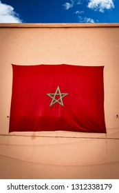 Morocco flag on high wall in Marrakesh