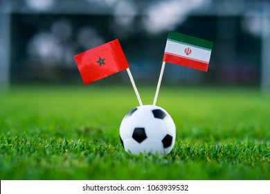 Morocco - IR Iran, Group B, Friday, 15. June, Football, National Flags on green grass, white football ball on ground.