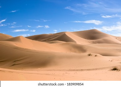 MOROCCO - JANUARY 10, 2014: Sahara desert dunes, clear blue sky