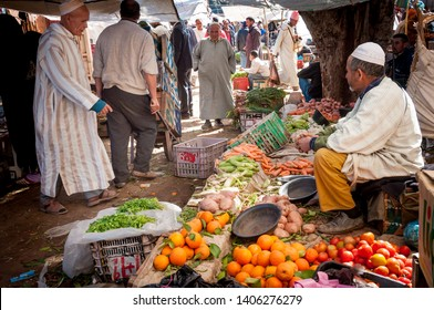 MOROCCO – MARCH 19, 2010: Unidentified people at a small rural village market near Marrakech in Morocco.