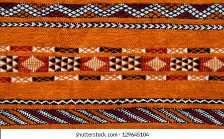 Morocco Marrakesh medina - detail ot typical Berber carpet on display - natural dyes and typical ancient Berber symbols