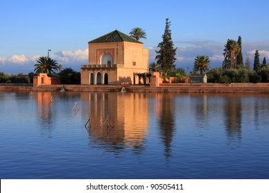 Morocco Marrakesh Menara Pavilion reflected on lake in late afternoon sunshine