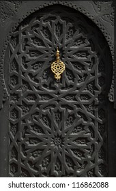 Morocco Marrakesh typical old arabesque door with brass door-knock.