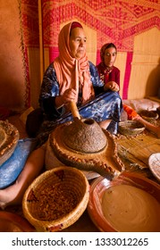 MOROCCO - OCTOBER 3, 2009:  Extracting oil from argan nuts, at Berber women's argan oil cooperative workshop, in Atlas mountains east of Marrakesh.