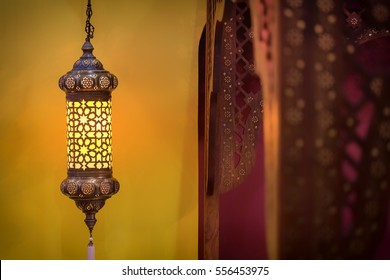 Morocco style lamp inside a moroccan interior bedroom at night.
