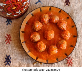 Morocco Tajine of Kafta - Typical Moroccan and Lebanese dish of meatballs in a tomato sauce with paprika cumin and garlic - cooked in a clay 'tajine' dish.