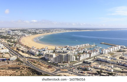 Morocco, view the beach and the marina and residential buildings of Agadir