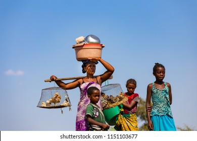 MORONDAVA-MADAGASCAR-OCTOBER-7-2017:The woman in Malagasy with her family looking the car on the road ,she's usually carrying basket on theirs head
