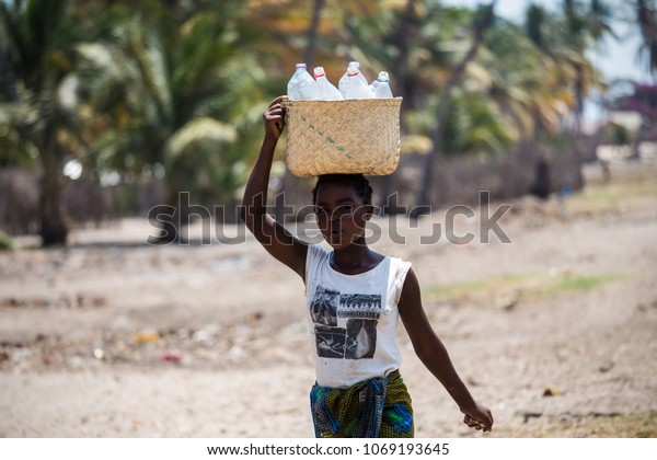 MORONDAVA-MADAGASCAR-OCTOBER-7-2017:The woman in Malagasy life style, they usually carrying basket on theirs head in the Fisherman village,Morondava