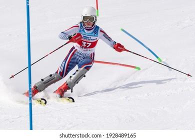 MOROZNAYA MOUNT, KAMCHATKA PENINSULA, RUSSIA - MARCH 28, 2019: Russian Alpine Skiing Championship, slalom. Mountain skier Kryukova Darya Chelyabinsk Region skiing down mount slope during competition