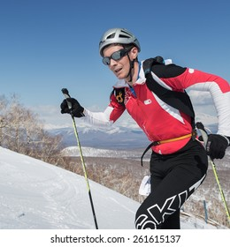 MOROZNAYA MOUNT, KAMCHATKA, RUSSIA - APRIL 25, 2014: Ski mountaineer Alexey Malt?ev climb on skis on mountain. Vertical race ski mountaineering Asian, ISMF, Russian, Kamchatka Championship.