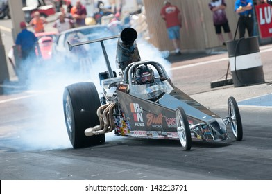 MORRISON, CO - JUNE 15: Gary Stinnett in his Super Comp dragster does a burnout during Thunder on the Mountain presented by Grease Monkey at Bandimere Speedway on June, 15, 2013 in Morrison, Co.
