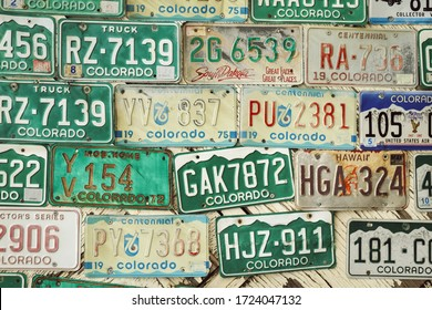 Morrison, Colorado/USA - 05.04.2015: Close-up of different license plates, most of them from Colorado state and others from different American states, set on a wall in old town Morrison, Colorado.