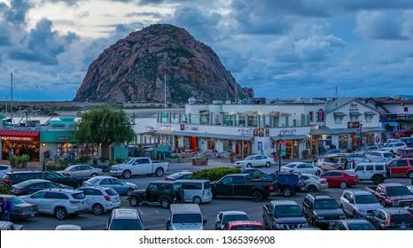 Morro Bay, California / USA - February 11 2017: Pier shops parking lot facing Morro Rock