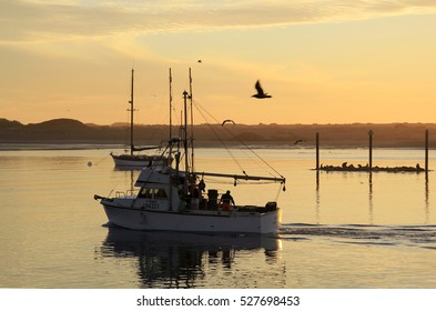 Morro bay, California, USA, Nov 8, 2011: Fishing ship at sunset followed back in bay