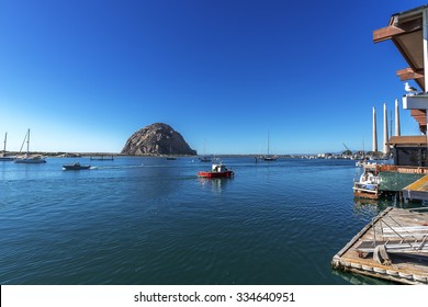 Morro Bay Harbor, Morro Bay Rock, fishing boats and the iconic power plant, with three visible stacks. Situated in San Luis Obispo County California, along the beautiful California Central Coast.