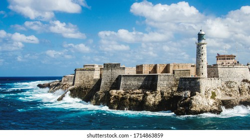 Morro castle on a clear day splashed by waves.