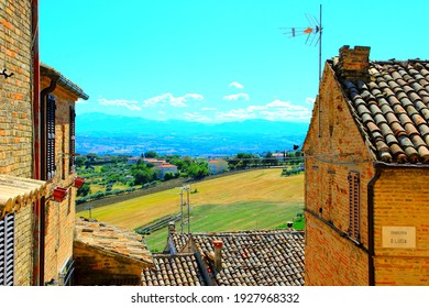 MORROVALLE, ITALY - CIRCA JULY 2020: View from Morrovalle. The village rests amidst wavy fields of grains, olive groves and grape vines, a picturesque setting of rural idyll