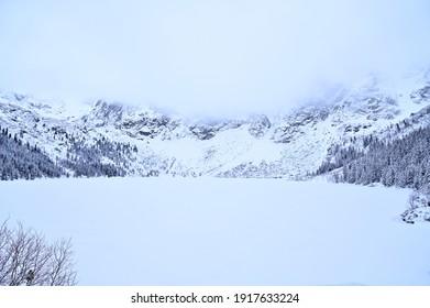 Morskie Oko lake, or Eye of the Sea, in a valley of polish Tatra Mountains, are a popular tourist destination in Zakopane, Poland - Shutterstock ID 1917633224