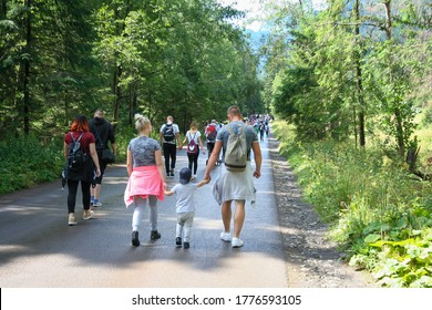 Morskie oko, Poland - August 08, 2019: Crowd in road to Morskie oko. Many people walking on footpath to famous place in Tatra Mountains. Many tourist.