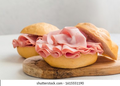 Mortadella sandwich. Mortadella Bologna - a large italian sausage or luncheon  with meat. Tipycal italian bread - La Rosetta.