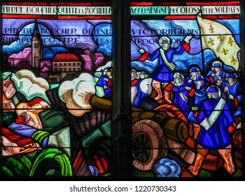 Mortagne-au-Perche, France - July 20, 2015: Stained Glass depicting Pierre Boucher and the French fighting the Iroquois in Quebec (17th Century) in the Notre Dame church of Mortagne, Perche, France