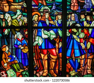 Mortagne-au-Perche, France - July 20, 2015: Stained Glass depicting the Departure of Pierre Boucher at La Rochelle for Quebec (17th C) in the Notre Dame church of Mortagne, Perche, France
