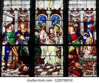 Mortagne-au-Perche, France - July 20, 2015: Stained Glass depicting the Beheading of St John the Baptist and the Dance of Salome in the Notre Dame church of Mortagne, Perche, France