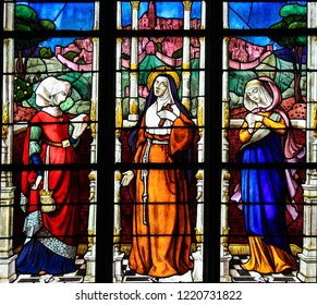 Mortagne-au-Perche, France - July 20, 2015: Stained Glass depicting the Countesses of Perche, Mahaut de Buviere, Marie d'Armagnac and Marguerite de Lorraine, in the Church of Mortagne, France