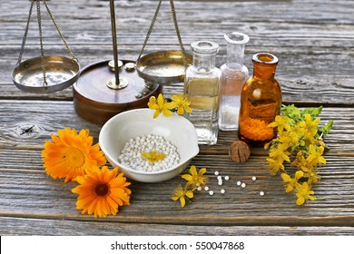 Mortal, scale, vintage glass-bottle. calendula, hypericum for homeopathic medicine