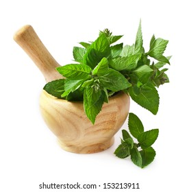 Mortar with fresh mint isolated on white background