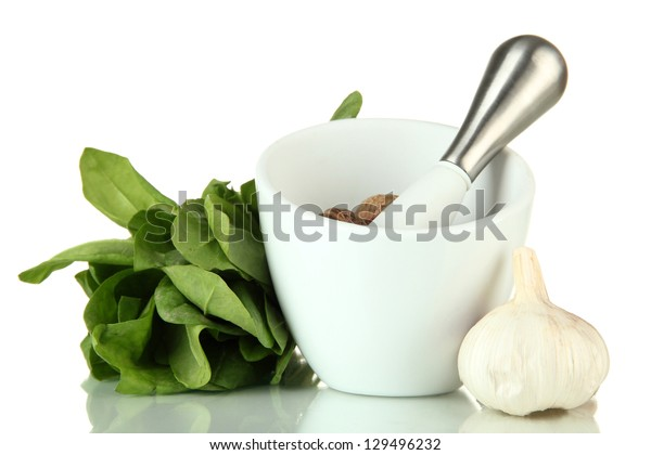Mortar, herbs and garlic, isolated on white