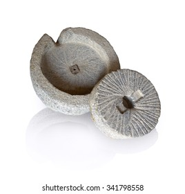 Mortar hewn aged grunge millwheel with handle and hole for processing seeds, fruits into farina powder, oil, spice for cooking isolated on white backdrop. Close-up view with space for text