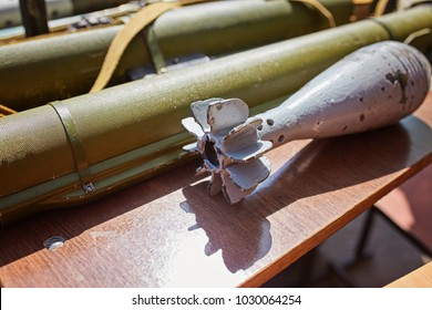 A mortar mine and a hand grenade launcher at the stand. Weapons of war in Ukraine