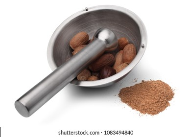 Mortar and pestle with nutmeg on white background