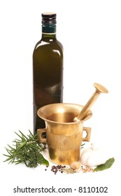 Mortar with a pestle and olive oil on white background.