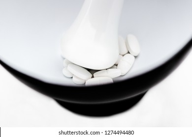 Mortar and pestle with pills and pill bottles