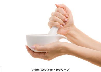 Mortar with pestle for spices in a female hand on a white background isolation
