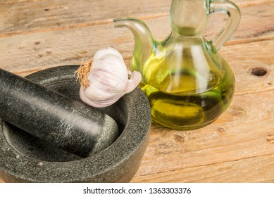 Mortar and pestle surrounded by alioli ingredients