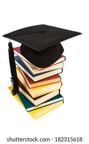 a mortarboard on a book stack, symbol photo for education and skills