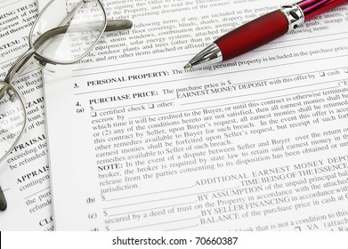 mortgage application contract document and pen