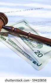 mortgage application, gavel and us dollars