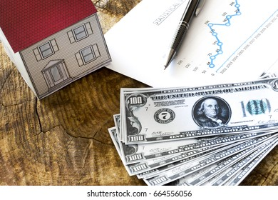 Mortgage, close up of home model, dollar money, investment, real estate and property concept