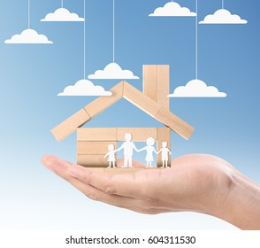 Mortgage concept by house from in a hand