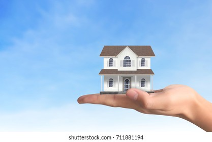Mortgage concept by house from in hand