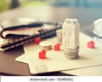 Mortgage concept by money house from the coins,Business Finance and Money concept,Saving concept to buy a house.